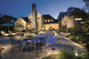 masonry home with patio and pool